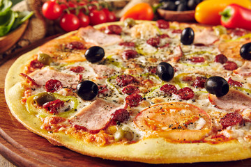 Meat pizza on wooden table close up