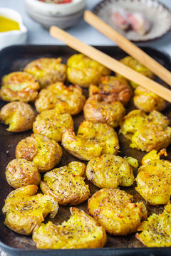 Homemade baked smashed baby potatoes with garlic, salt and herbs