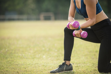 sporty woman does the exercises with dumbbells photo of muscular woman in sportswear strength and motivation.