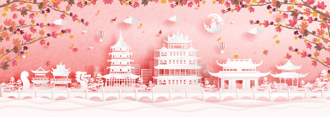 Wall Mural - Autumn in Hangzhou, China with falling maple leaves and world famous landmarks in paper cut style vector illustration