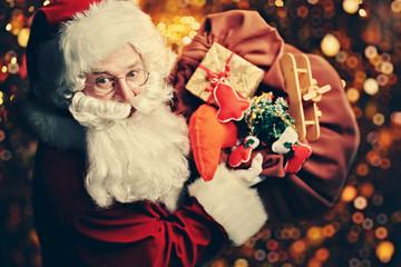 closeup of Santa with gifts