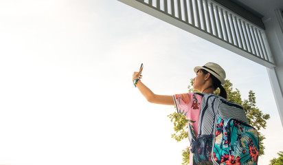 Tourists, Asian girls, selfies and fun taking pictures with mobile phones in tourist attractions