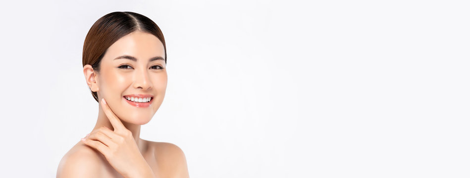 Beauty shot of beautiful bright skin Asian woman on white banner background