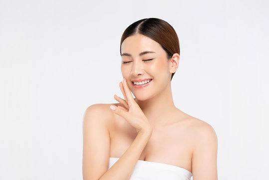 Youthful bright skin pretty Asian woman with hand touching face and eyes closing
