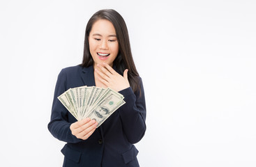 Closeup portrait of beautiful asian business woman holding money. Pretty asian girl counting her salary dollar note. Success wealth financial business cashflow currency bill payment concept