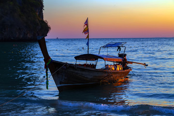 Long tail boat summer sunset