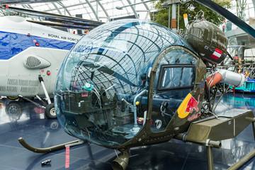 SALZBURG, AUSTRIA - DEC 2019. Aviation Museum Hangar 7, helicopter BO 105 CB, Douglas DC-6B aircraft, racing cars, Salzburg, Salzburg State, Austria