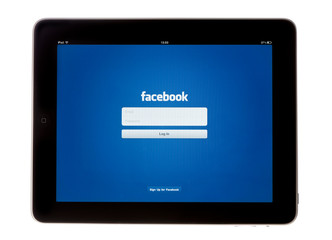 Bath, United Kingdom - November 9, 2011: An Apple iPad showing the log in screen of the Facebook App, shot against a white background.