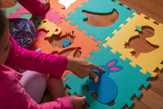 baby Puzzle with colourful letters.  family time