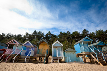 A row of bright Beach Huts in Wells-Next-The-Sea, Norfolk, UK