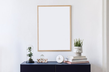 Stylish scandinavian living room with mock up poster frame, navy blue commode, plants, clocl and elegant accessories. Modern home decor. Interior design. Template Ready to use.