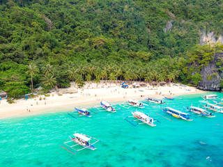 Aerial view of 7 Commando Beach on paradise island, tropical travel destination, El Nido, Palawan, Philippines