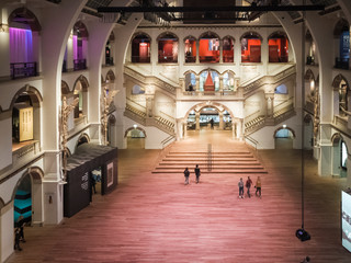 Tourists visit the beautiful interior entrance hall of the Museum of the Tropics (Tropenmuseum) in Amsterdam, the Netherlands, on October 23, 2019