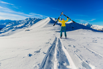 Woman with ski in high mountains.