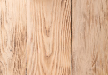 The texture of pine planed boards. Use as background. Light bright wood texture.