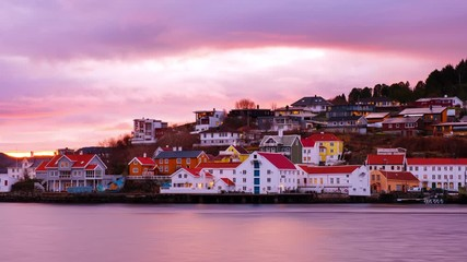 Wall Mural - Kristiansund, Norway. View of city center of Kristiansund, Norway during the cloudy morning at sunrise with colorful sky. Time-lapse of port with historical buildings