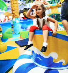 cute little girl playing on inflatable attraction.