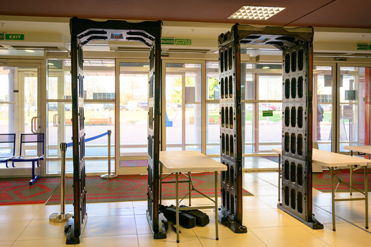 Photo of a metal detector frame in a building.