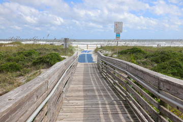 Blue roll out mat for handicapped beach access to Amelia Beach, Florida, USA.