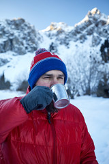 Traveler with cup of coffee at mountains