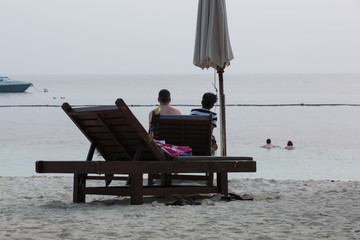 Couple sitting together at perhentian islands in Teregganu in Malaysia