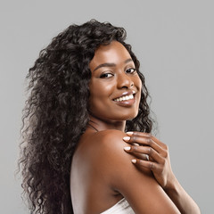Fototapete - Happy curly black girl with clean fresh skin and perfect smile