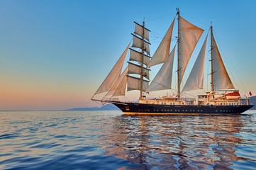 Luxury sailing yacht under sail with sunshine