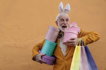 Happy old man in funny band with presents stock photo