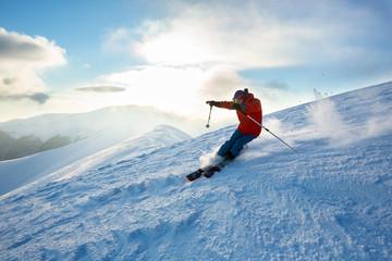 Fototapete - Off piste skiing, Winter day, sunset.