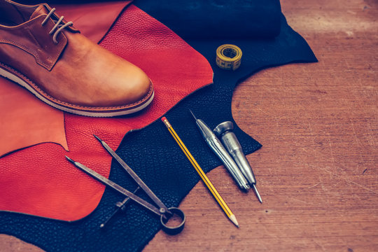 Brown shoes and leather shoemaking tools and set of leather craft tools