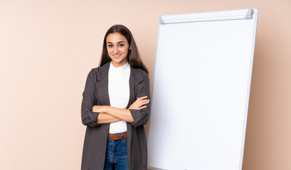 Young woman giving a presentation on white board smiling a lot