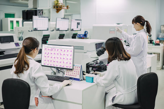 Medical doctor or health sciences professional working for analyzing blood samples in laboratory of scientific research. Concept for biology chemistry HIV hematology and medical equipments safety lab.