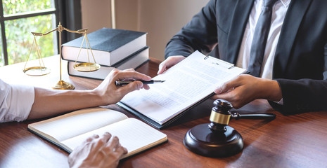 Male lawyer discussing negotiation legal case with client meeting with document contact in courtroom, law and justice concept