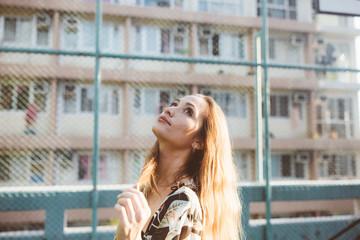 Candid portrait of beautiful Eurasian woman outdoor