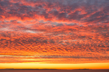 Fiery Orange Sunrise Sky with Dramatic Mackerel Cloud Formation