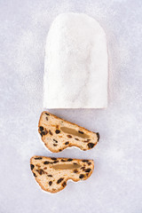 Christstollen, German Stollen and Two Slices on Background with Icing Sugar