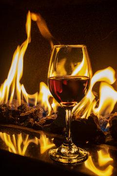 Single red wine glass on fireplace