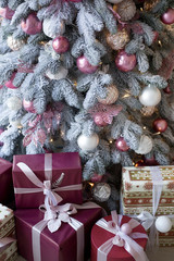 Christmas tree and gifts close up