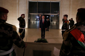 Irish FM Coveney lays a wreath on the tomb of late Palestinian leader Arafat in Ramallah