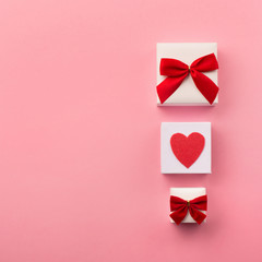 Valentines gift boxes, red bow and felt hearts