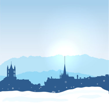 Lausanne winter skyline with mountains and snow.