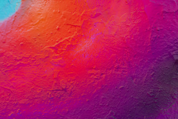 Foto op Plexiglas Graffiti Beautiful bright colorful street art graffiti background. Abstract creative spray drawing fashion colors on the walls of the city. Urban Culture, pink , red , orange , green, crimson , purple texture