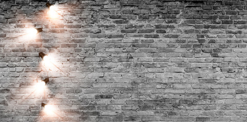 Brick wall with a garland of lanterns. Brick wall background, festive look.