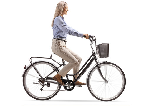 Young woman in formal clothes riding a bicycle