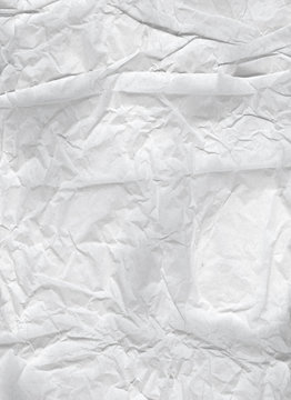 Crumpled paper. Light wrinkled wrapping paper for backgrounds. Portret format - Vertically located.