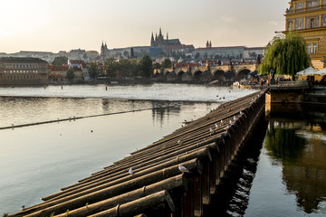 View of the Vltava river, Prague castle and Charles bridge in Prague.