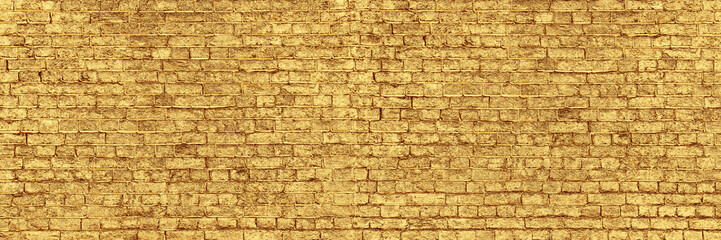 Panoramic Wall of Golden Bricks. Wide Banner for Web With Textured Gilded Surface. Luxury Facade or...
