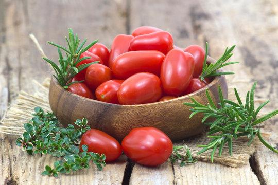 mini roma tomatoes and herbs