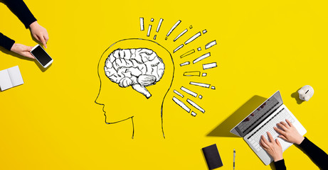 Brain illustration with people working together with laptop and phone