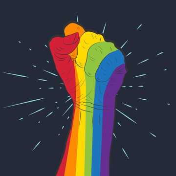 Rainbow colored hand with a fist raised up. Gay Pride. LGBT concept.